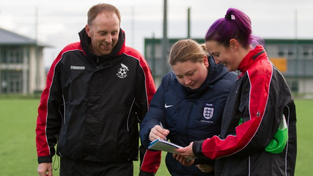 Female Coach mentor working with coaches