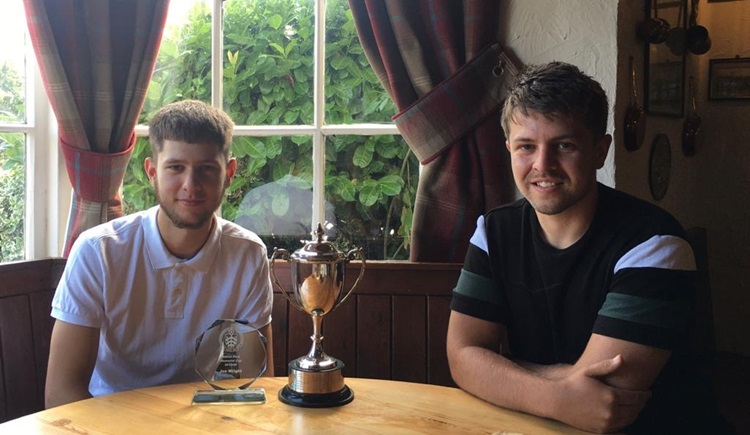 Under 18 Representative manager Calum Wands, presenting the Simon Ford Memorial Trophy to this year's winner, goalkeeper and captain Joe Wright