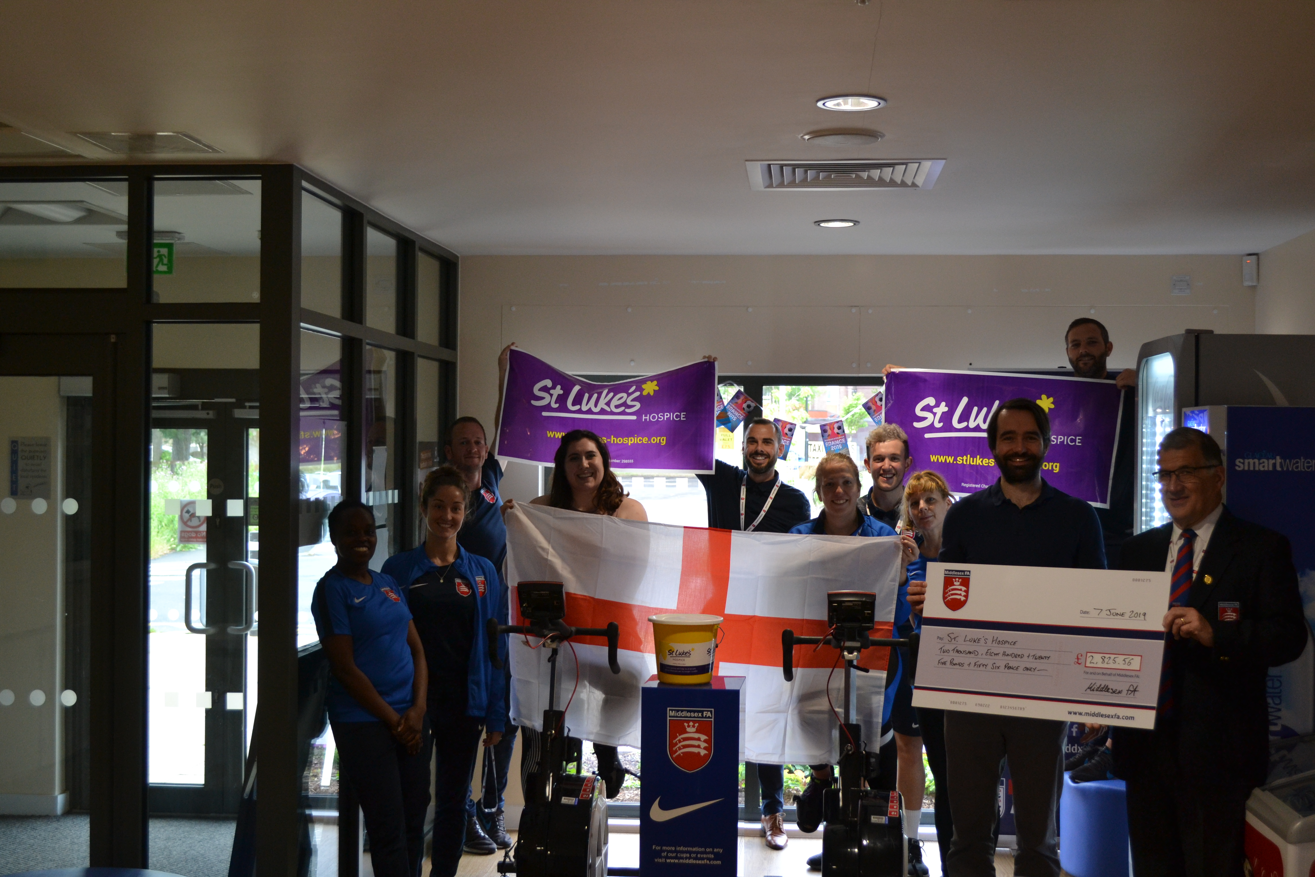 Middlesex Team present cheque to St Luke's rep