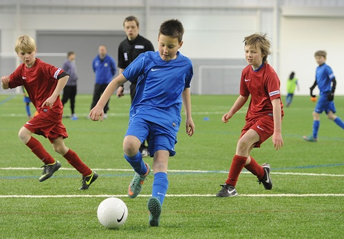 Young players in action.