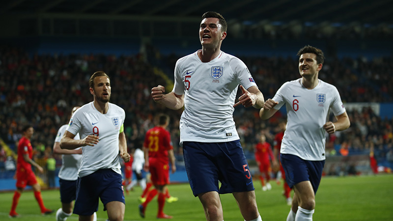 Michael Keane celebrates his goal in Podgorica