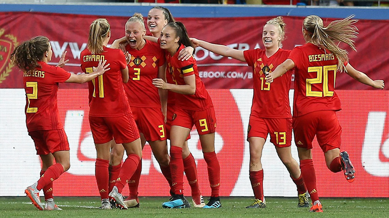 Belgium celebrate scoring one of their three goals against England