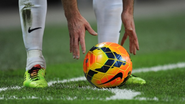 a footballer putting the football in place before kicking