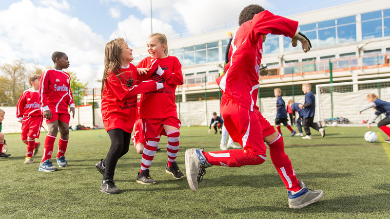 Youngsters enjoy a training session at The University of Nottingham school football tournament