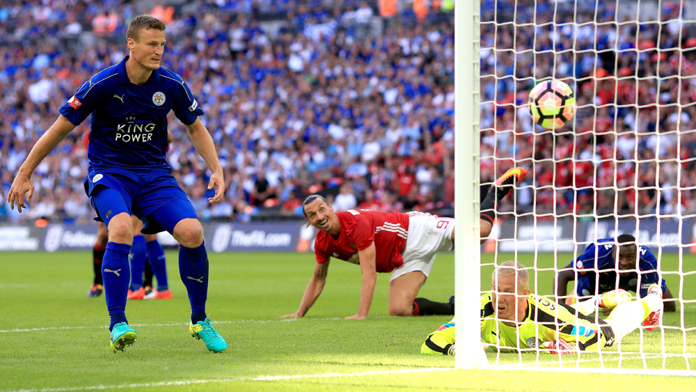 Zlatan Ibrahimovic watches the ball sail past Kasper Schmeichel