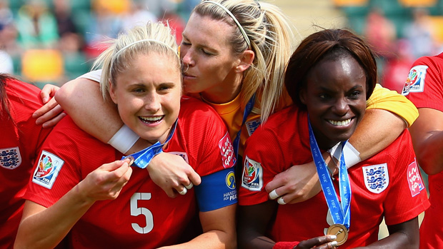 Steph Houghton (left) celebrates bronze with Carly Telford (centre) and Eniola Aluko