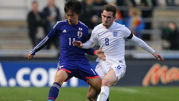 England U19s captain Lewis Cook in a tussle against Japan