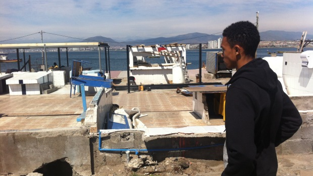Alexander-Arnold examines the devastation of the tsunami