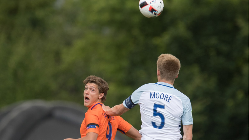 England U19s captain Taylor Moore towers over Dutch striker Sam Lammers to win a header