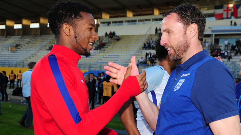 Gareth Southgate and Kasey Palmer celebrate victory in the Toulon Tournament.