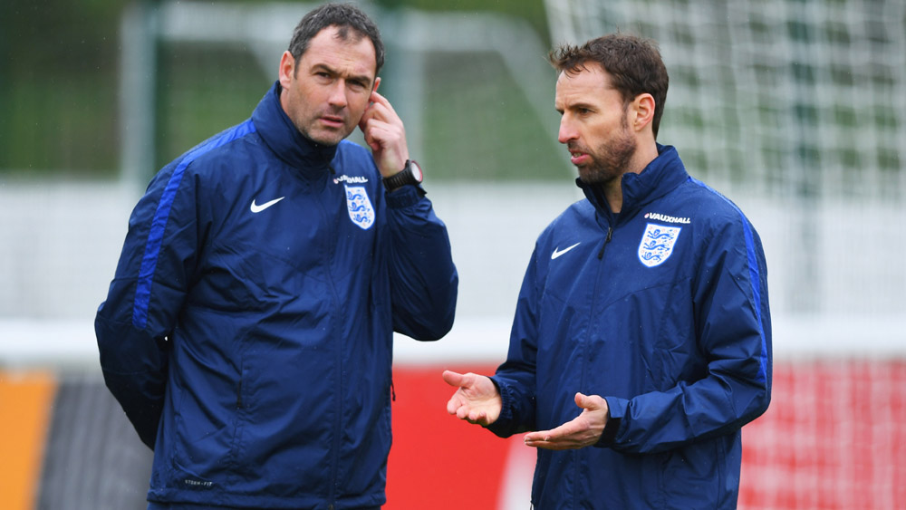 Paul Clement talks tactics with Gareth Southgate at St. George