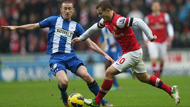 Arsenal midfielder, Jack Wilshere in action against Wigan Athletic