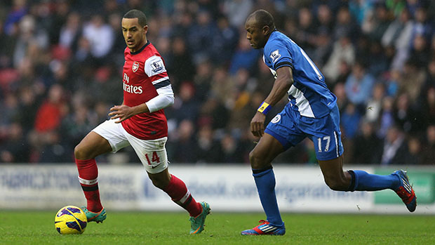 Arsenal forward, Theo Walcott in action against Wigan Athletic