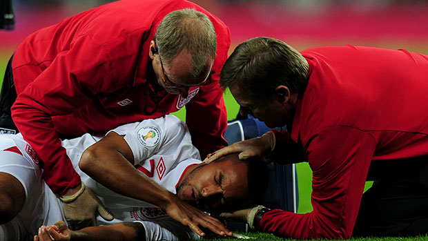 England forward, Theo Walcott, receives treatment on the field