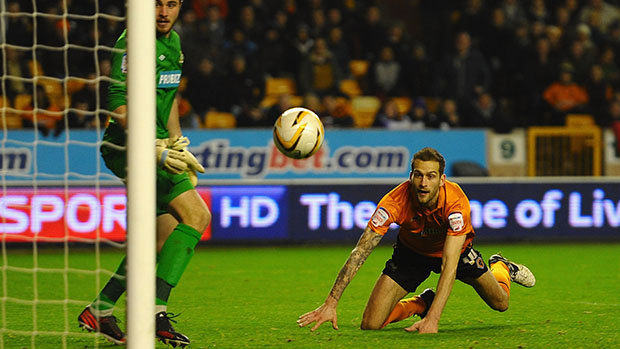 Roger Johnson heads the equaliser for Wolves