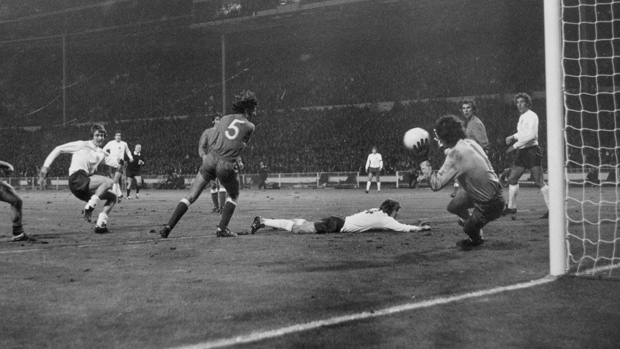 Poland 'keeper Jan Tomaszewski saves from Allan Clarke at Wembley in 1973