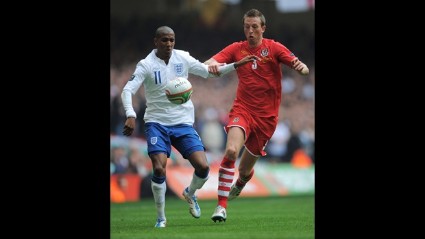 Ashley Young comes up against Danny Collins in Cardiff.