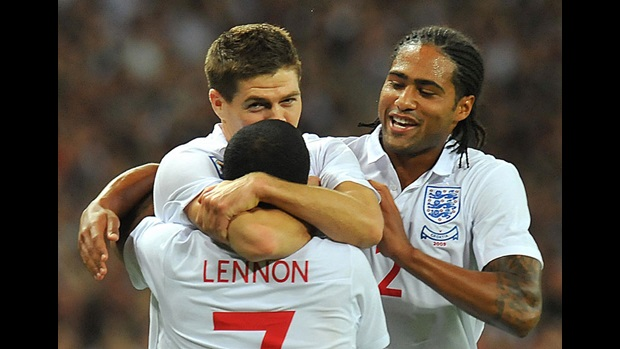 Aaron Lennon, Steven Gerrard and Glen Johnson celebrate against Croatia.