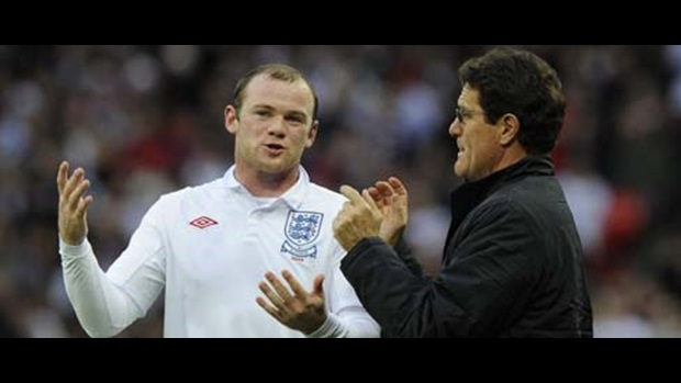Fabio Capello discusses tactics with Wayne Rooney.