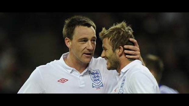 John Terry and David Beckham celebrate a goal.