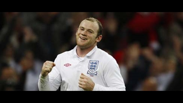 Wayne Rooney celebrates his first, and England's second, against Slovakia.