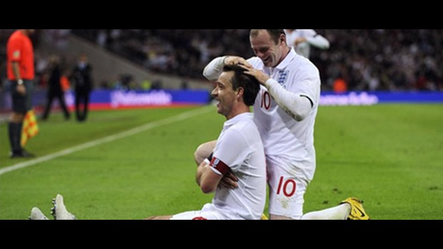 Wayne Rooney congratulates John Terry on his winner against Ukraine.