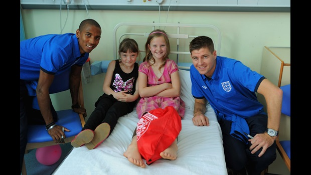 Ashley Young and Steven Gerrard pose for a photograph at Watford General.