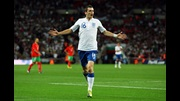 Adam Johnson celebrates his first goal for England.