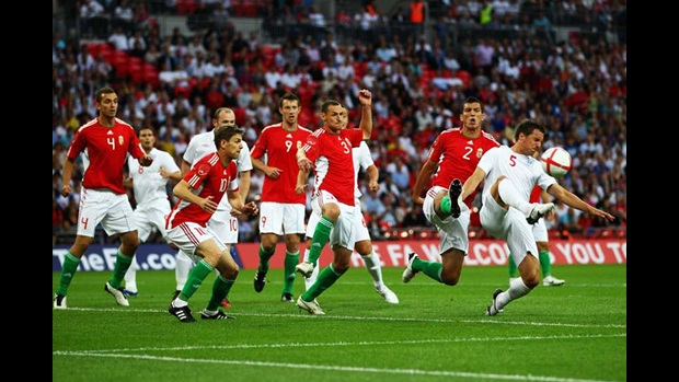 Phil Jagielka attacks a corner against Hungary.