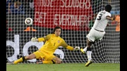 Asamoah Gyan slots home a late penalty to give Ghana a 1-0 victory over ten-man Serbia.