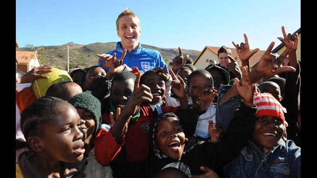 Michael Dawson visits orphans at the SOS Children's Village in Rustenburg.