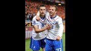 Robin van Persie (l) and Rafael van der Vaart celebrate the former's goal against Cameroon in the group stage.