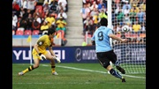 Luis Suarez opens the scoring for Uruguay against South Korea.