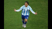 Carlos Tevez celebrates one of his two goals against Mexico in the World Cup.