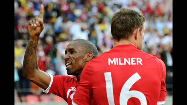 Jermain Defoe and James Milner celebrate