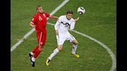 Matthew Upson contests a high ball with Slovenia's Zlatko Dedic.