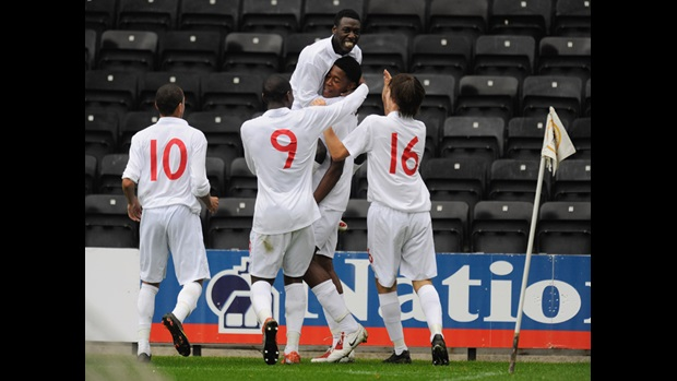 Chuks Aneke is congratulated by Bruno Pilatos and team-mates after scoring the winner against Portugal in The FA International U17 Tournament in 2009.