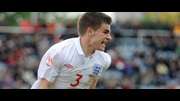 Luke Garbutt wheels away in delight after equalising for England.