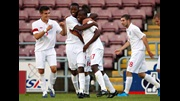 England U17 players congratulate Saido Berahino (centre) after the forward scored against Turkey in The FA International U17 Tournament in August 2009.