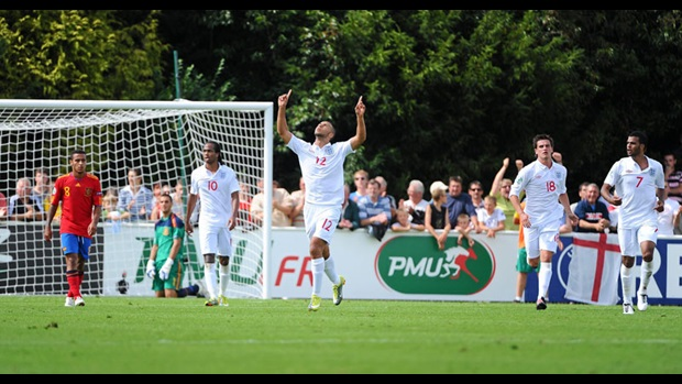 John Bostock celebrates scoring against Spain.