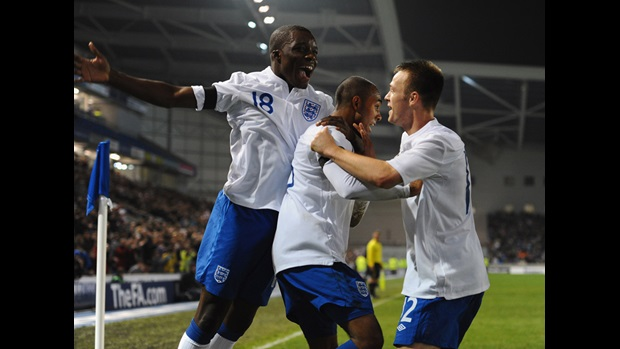 Rob Hall (centre) is congratulated on his winner against Denmark at Brighton's Amex Stadium.