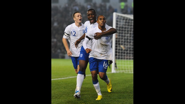 Rob Hall (right) is congratulated by Aziz Deen Conteh (centre) and Todd Kane (left) after scoring the winner against Denmark at Brighton's Amex Stadium.