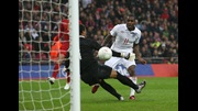 Danny Rose steers the ball beyond Portugal goalkeeper, Hugo Ventura, to score England's winning goal at Wembley Stadium