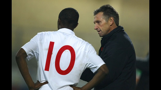 Kenny Swain relays some information to England forward, Matthias Fanimo