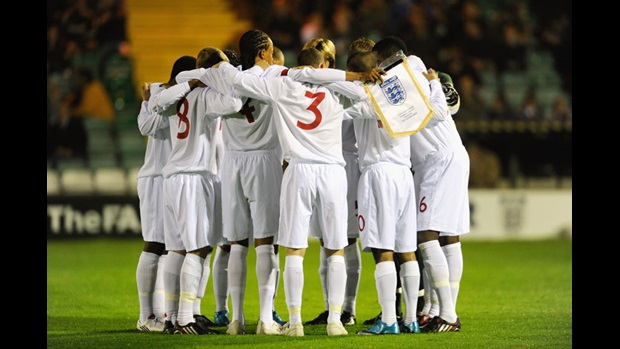 The England U16 team huddle together ahead of the Victory Shield encounter against Wales in October 2009.