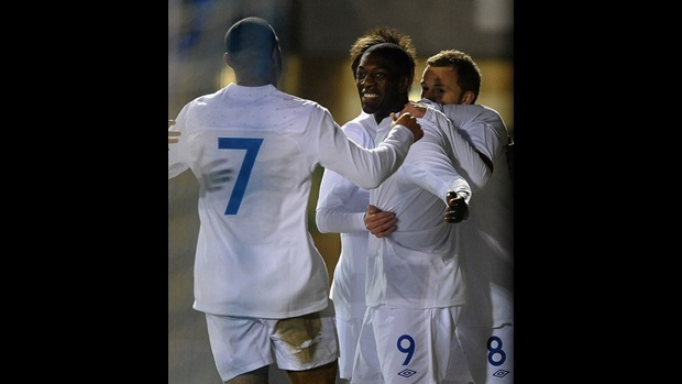 England celebrate their opening goal against France.
