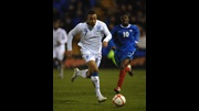 Matt Phillips runs with the ball against France.