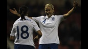 Steph Houghton celebrates her goal against Slovenia with Rachel Williams.