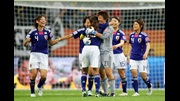 Japan celebrate their Semi-Final win over Sweden.