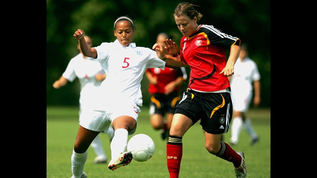 Everton defender Fern Whelan wins the ball cleanly against Germany.